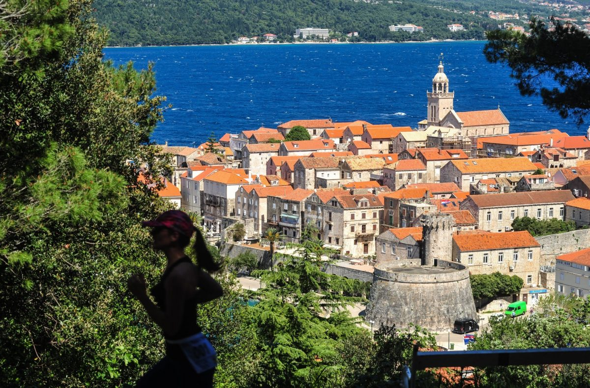 Korčula and a woman running