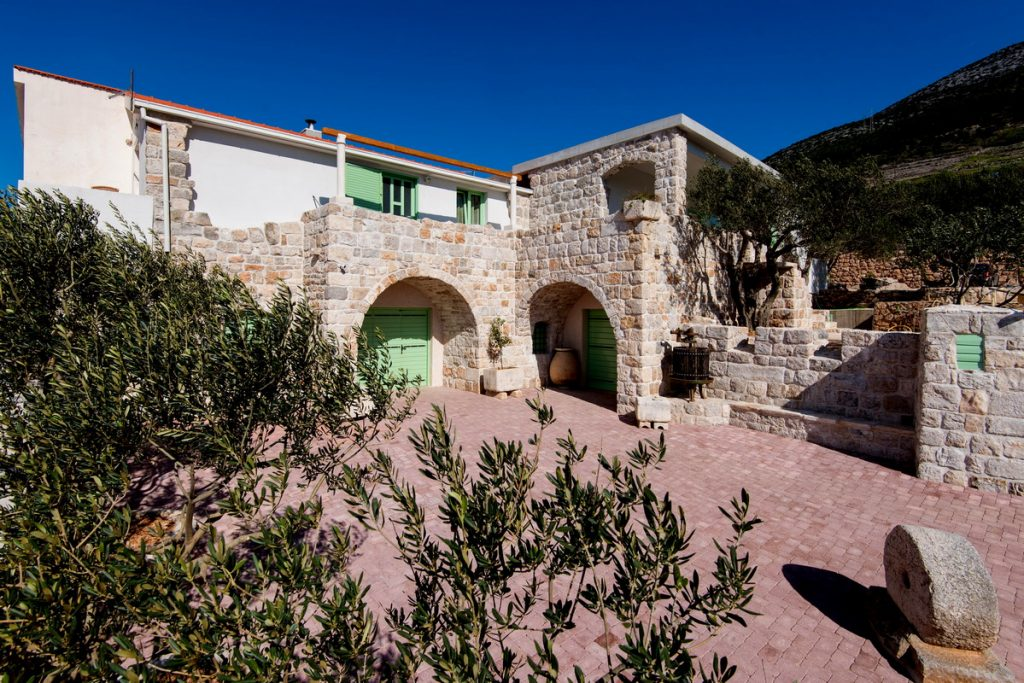 stone house with olive trees