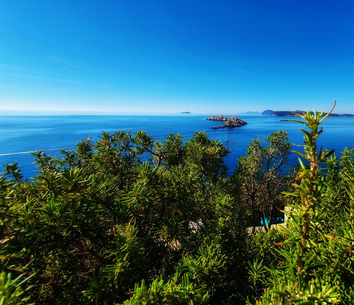 Panorama of the sea and Grebeni islet and lighthouse